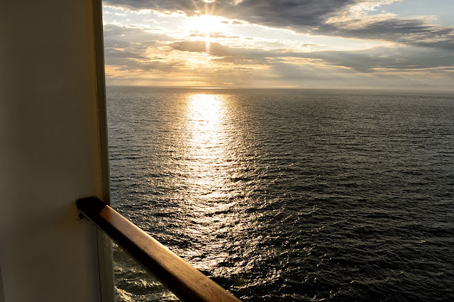 Sunset on the balcony of the Norwegian Pearl