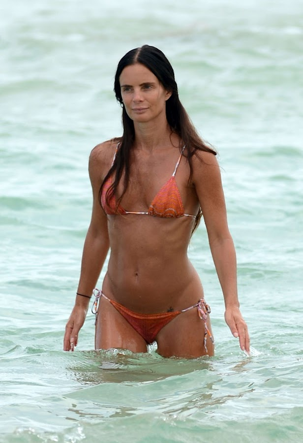 GABRIELLE ANWAR orange bikini image from Miami beach