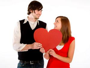 Most Common Things That Men Do To Impress Women - man and woman holding a heart