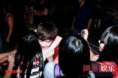 Greyson Chance smothered by fans in Hong Kong - July 2012