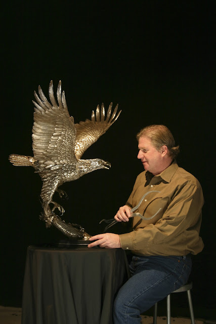 Michael Maiden and silver eagle sculpture