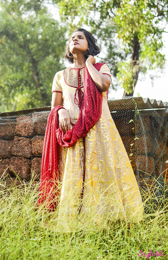 Dayle Pereira, blogger at Style File, starts the festive season in India post Diwali in a traditional salwar kameez suit in ethnic shades of red and gold with a red lip and gold accessories