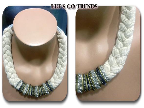 Collar de trenza de hielo en blanco roto con cuentas de colores grises y demás detalles en el centro del collar. Costaba 7,95\u20ac y quedó a mitad de precio.