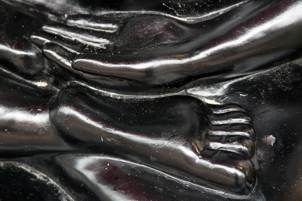 hands and feet of black buddha