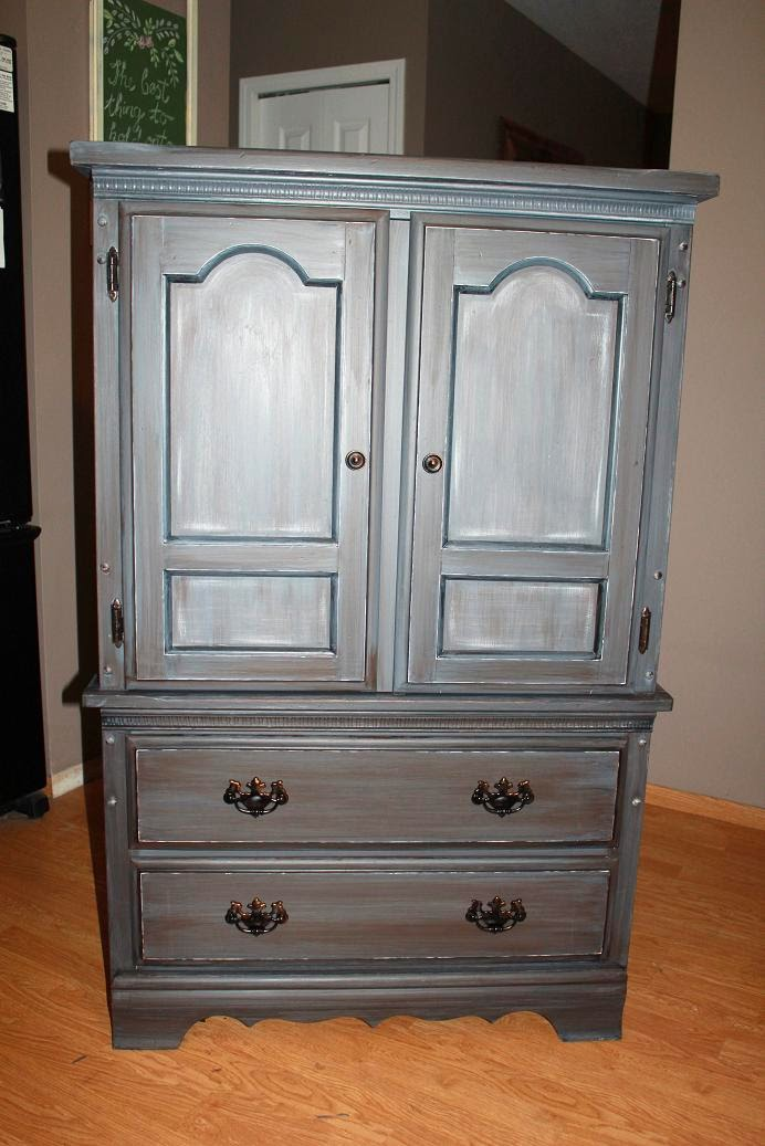 New eyes and extra colours: Grey distressed armoire