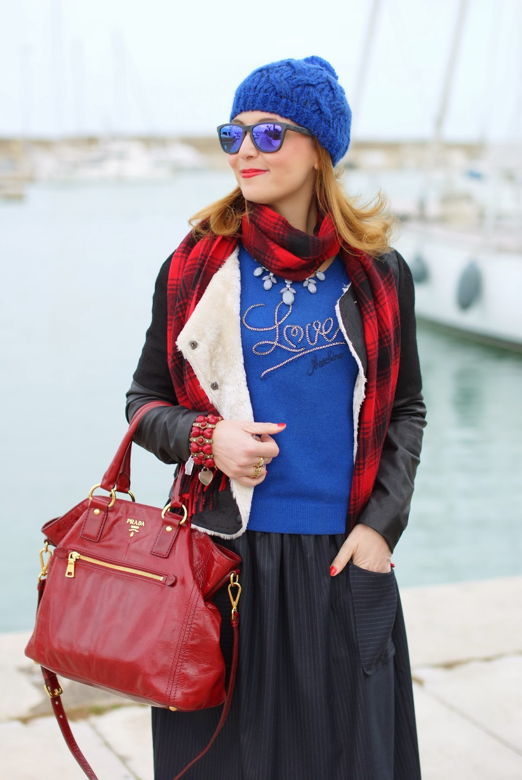 cobalt blue beanie, Oakley sunglasses, red Prada tote, Asos midi skirt, Fashion and Cookies, fashion bloggern and Cookies, fashion blogger