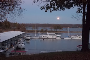 Beautiful full moon over a calm KenLake Marina.