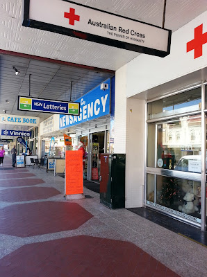 Australian Red Cross op shop in Goulburn, with Vinnies sign several doors down.