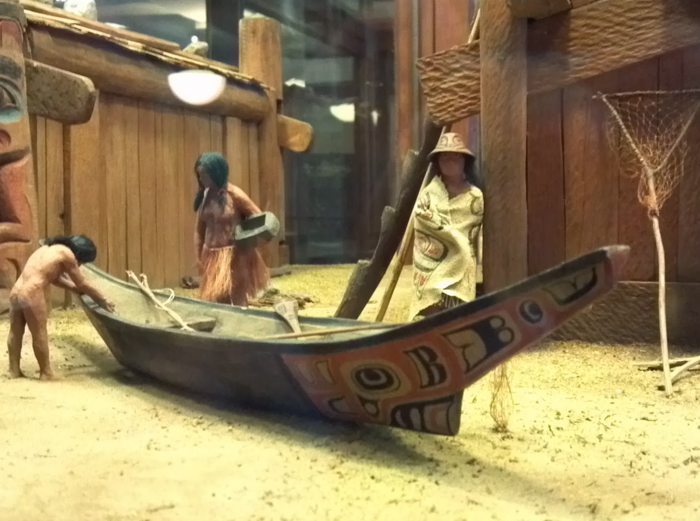 Close Up Of The Same Canoe Showing Details Painted Decoration And Bow Skeg At Extreme Right A Dip Net Different Pattern Rests Against
