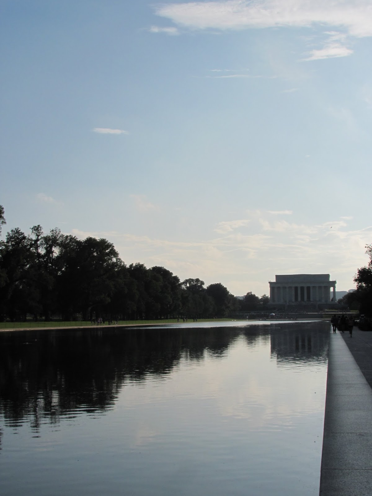 The Lincoln Memorial is seen from the distance along the reflecting pool in Washington, DC