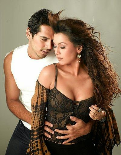 mahima chawdhary with her co-star dino morea possing for a hot steamy photoshoot