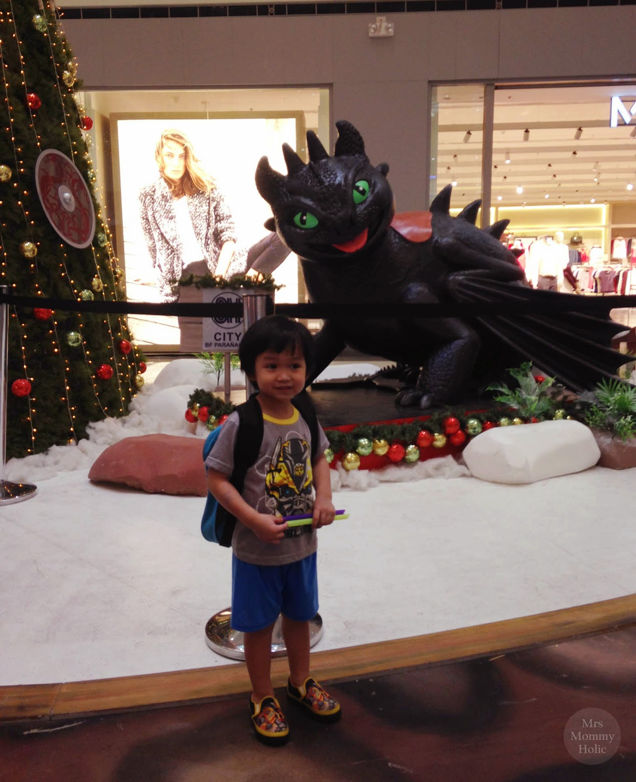 right beside the toothless display is the giant christmas tree which is a perfect spot for a nice family picture as well - How To Train Your Dragon Christmas