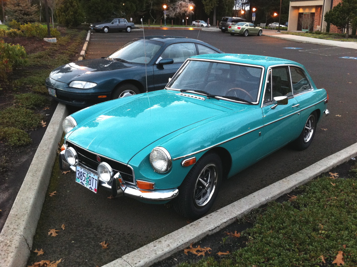 OLD PARKED CARS.: 1970 MG GT coupe.