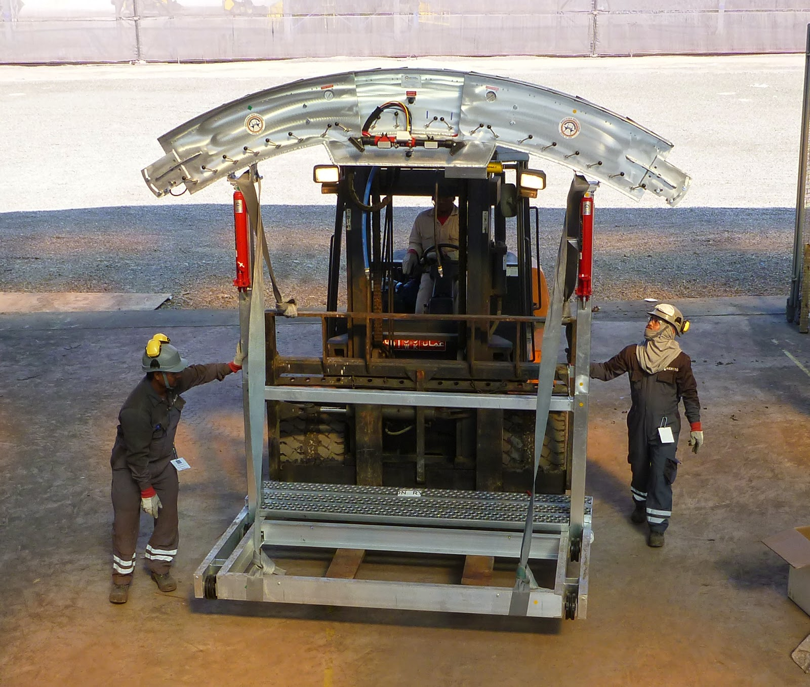 Installation of the center arch with the support of 3 ton capacity fork lift.
