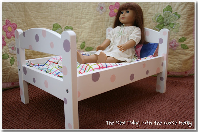 American Girl Doll craft to make a personalized doll bed from a plain IKEA doll bed. Too cute! #AmericanGirlDoll #Crafts #IKEA #RealCoake