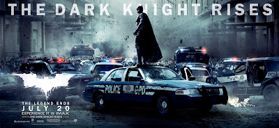 A banner image for the film The Dark Knight Rises showing Batman in the streets of Gotham City.