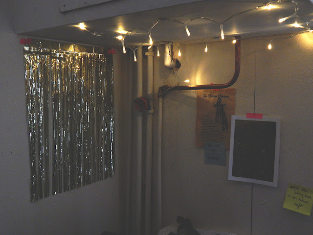 decorations and fairy lights in the corner of a room