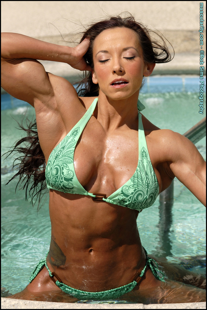 Patricia Beckman Flexing Her Lovely Muscles In A Green Bikini