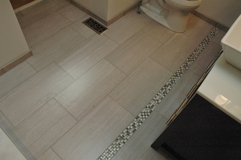 tile with decorative mosaic inlay in floor for bathroom floor title=