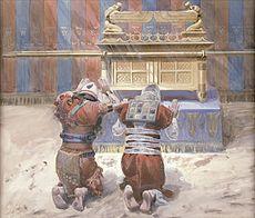 Moisés y Josué postrados ante el Arca.