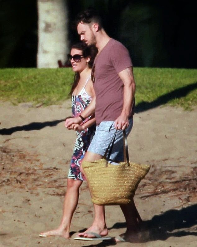 Wonderful time of year when celebrities start showing some serious skin ans Lea Michele hit the beach and soak in some sun with boyfriend, Matthew Paetz.  The 28-year-old was at Mexico on Monday, December 29, 2014 and ensured her best assets in a white string bikini were well and truly on display.