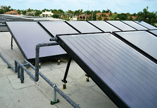 An impressive array of Aurora Solene solar water heating collectors at the exclusive Admiral's Cove yacht club in Florida.