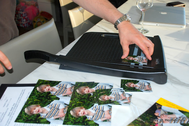 cutting school photos with a paper cutter