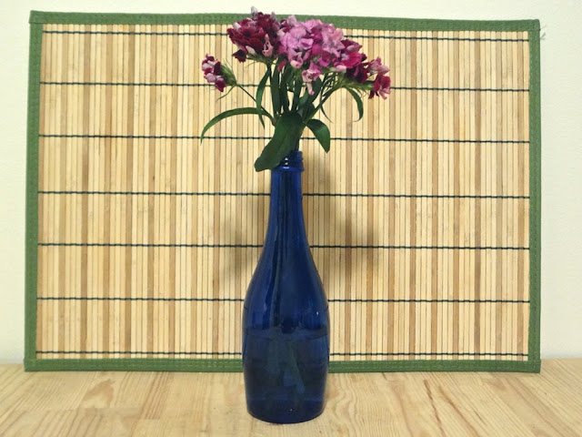 flowers in blue bottle