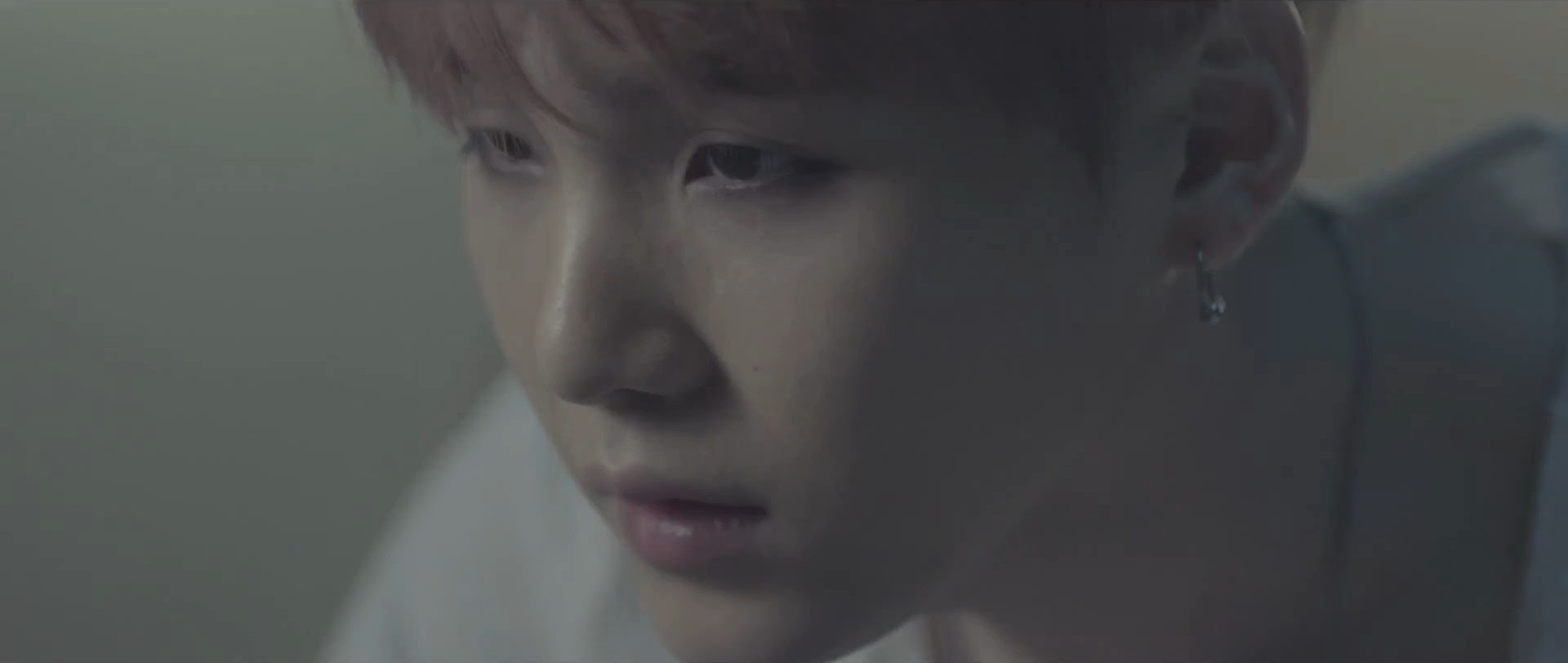 Bangtan's SUGA in I Need You MV