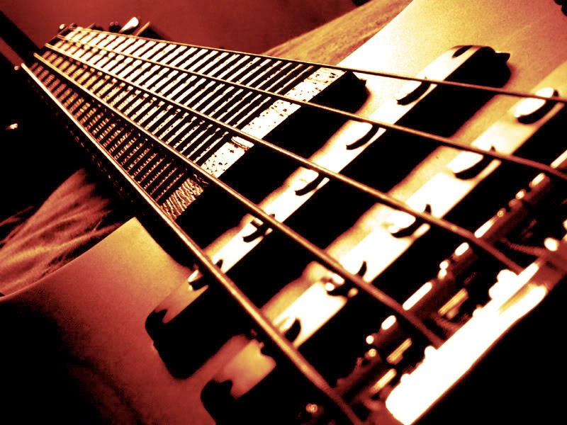 Learn to Play Bass Guitar - 4 Guitar Playing Tips