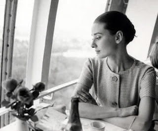 Audrey Hepburn looking out a window