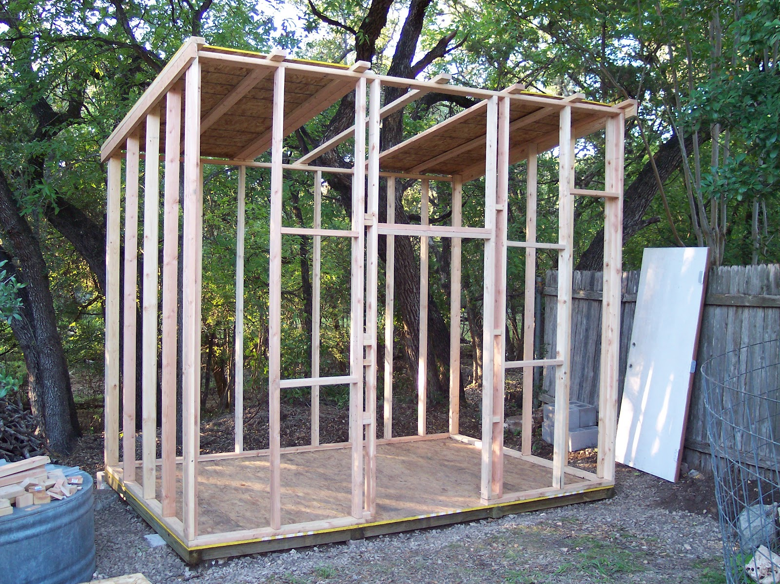 Rock oak deer texas style shed project for How to build a sloped roof shed