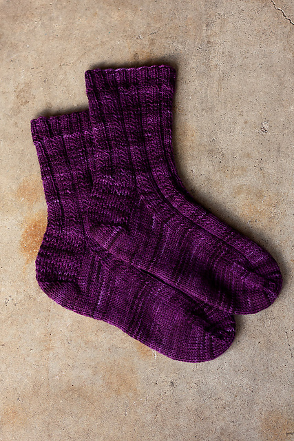 Chicken soup designs easy textured socks so far ive knit this pattern up in a lovely tonal stripe in araucania ranco solid in eggplant dt1010fo