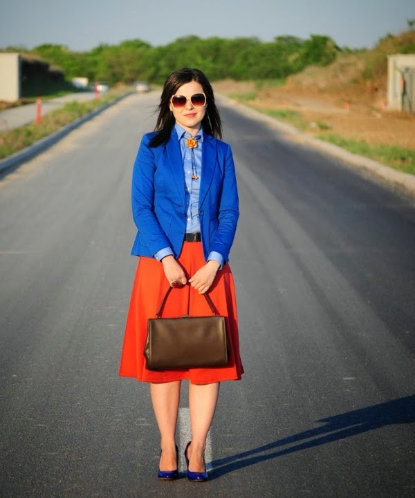 orange skirt and blue blazer