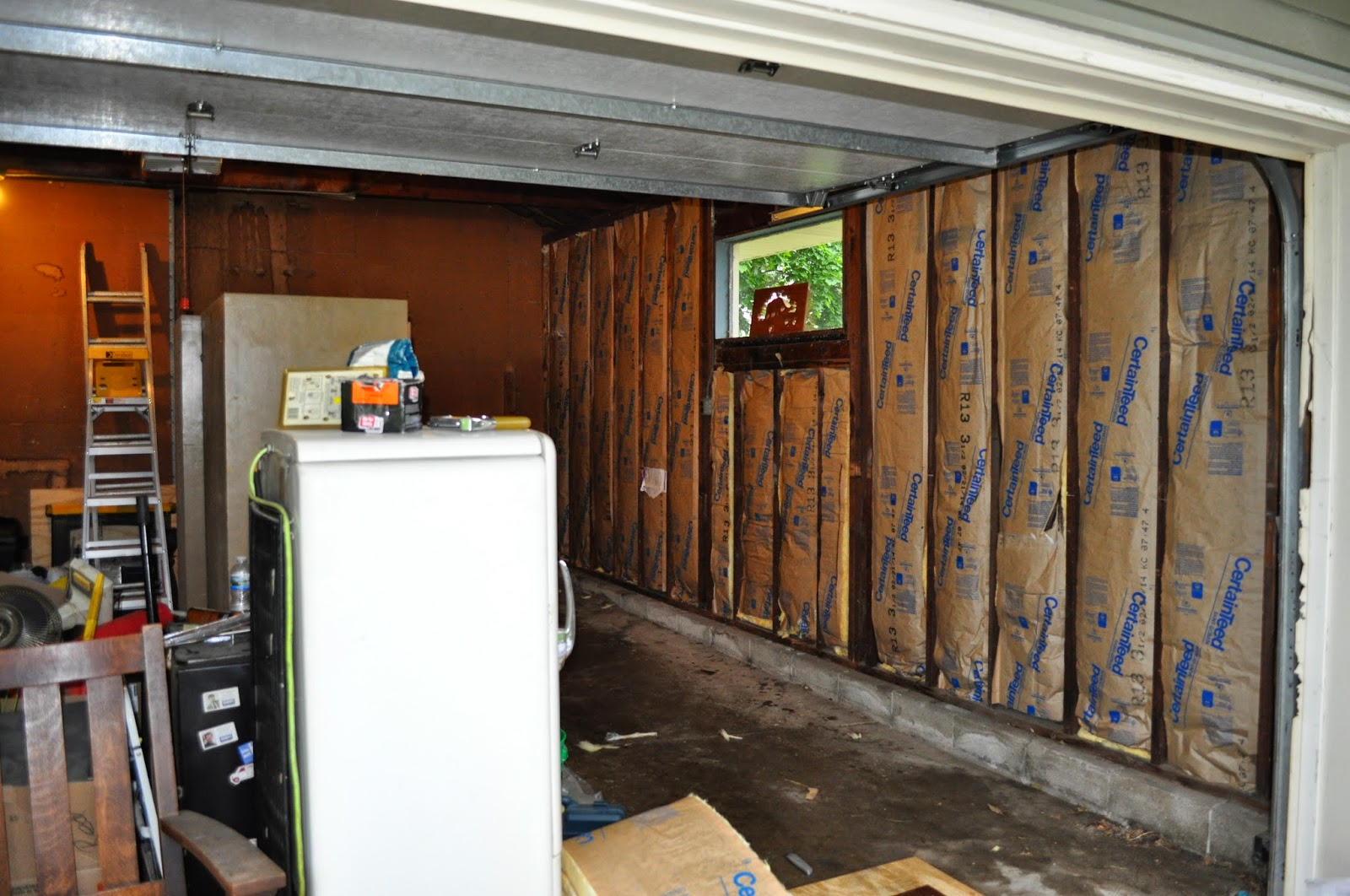 garage, garage organization, organization, flooring, drywall, pirate flag, mudding, insulation, garage project, diy, reno
