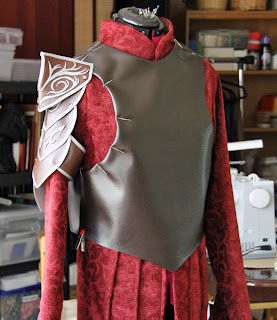 Preparing the armor vest of the Elrond costume.