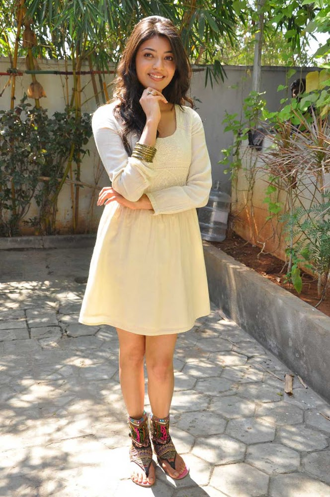 Kajal Agarwal Very Hot Pictures In White Mini Skirt And Cute Expressions With Smiling Face