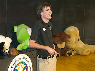 Randy Pausch displays the stuffed animals he had won during his younger years at his last lecture