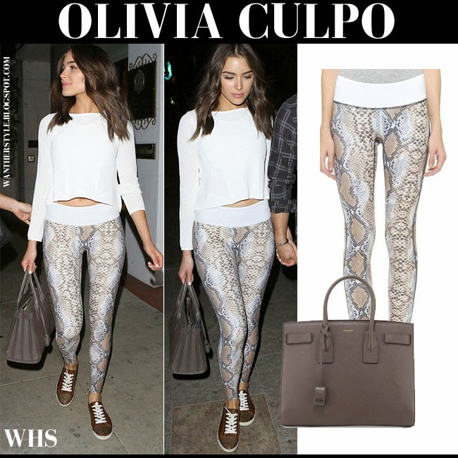 Olivia Culpo in white crop top with python snake print Prismsport leggings and dark grey brown tote Saint Laurent what she wore casual style april 29