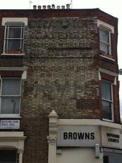 Ghost sign on Kilburn Park Road, London NW6