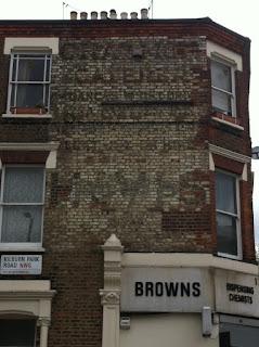 Ghost sign on Kilburn Park Road, London NW6