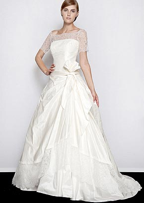 A+fine+contrast+of+lace+decorates+the+bodice+and+taffeta+hem+Apparel+Victoria%2527s+Bride