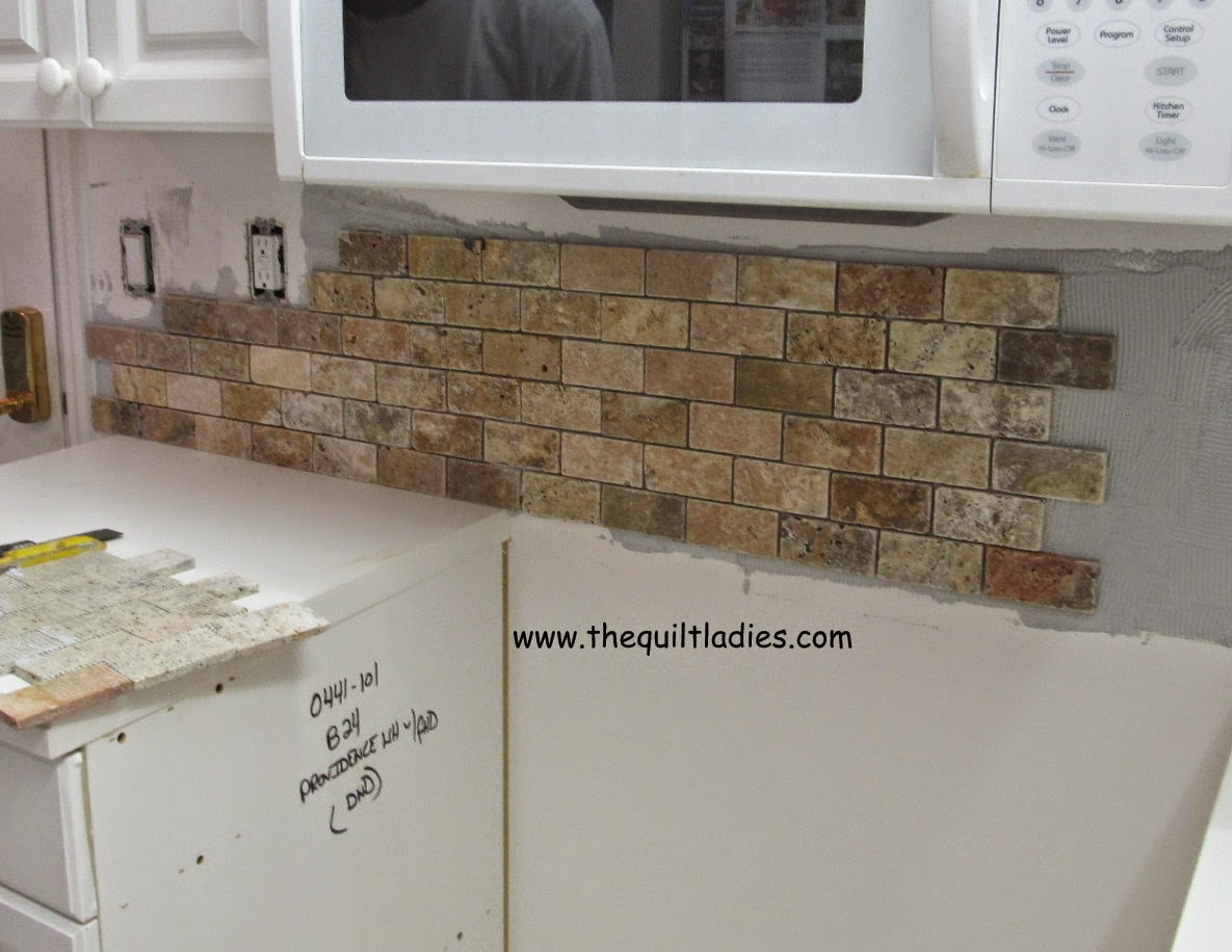 back splash added to kitchen in condo