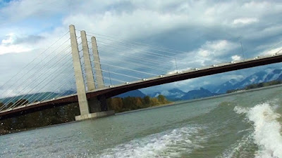 View of Pitt River Bridge and surrounding mountains