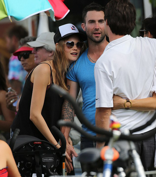 Maroon       s Adam Levine has found himself a replacement for Anne V  He     s now hooking up with Behati Prinsloo and the hot new couple were seen together