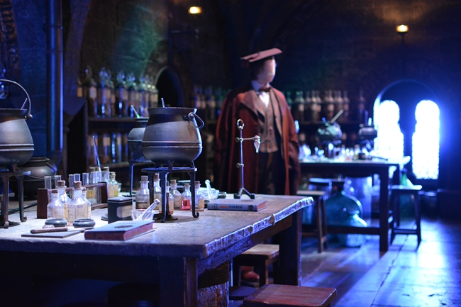 Potion bottles in the classroom at Hogwarts with Slughorn