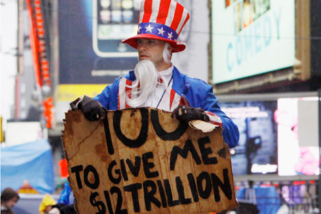 U.S. public debt sign held by Uncle Sam