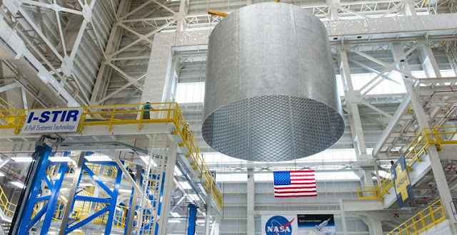 Engineers at NASA's Michoud Assembly Facility transfer a 22-foot-tall barrel section of the SLS core stage from the Vertical Weld Center. Credit: NASA