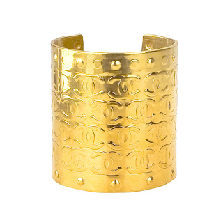 "Vintage 1990's large gold Chanel cuff bracelet with engraved ""CC"" logo pattern."
