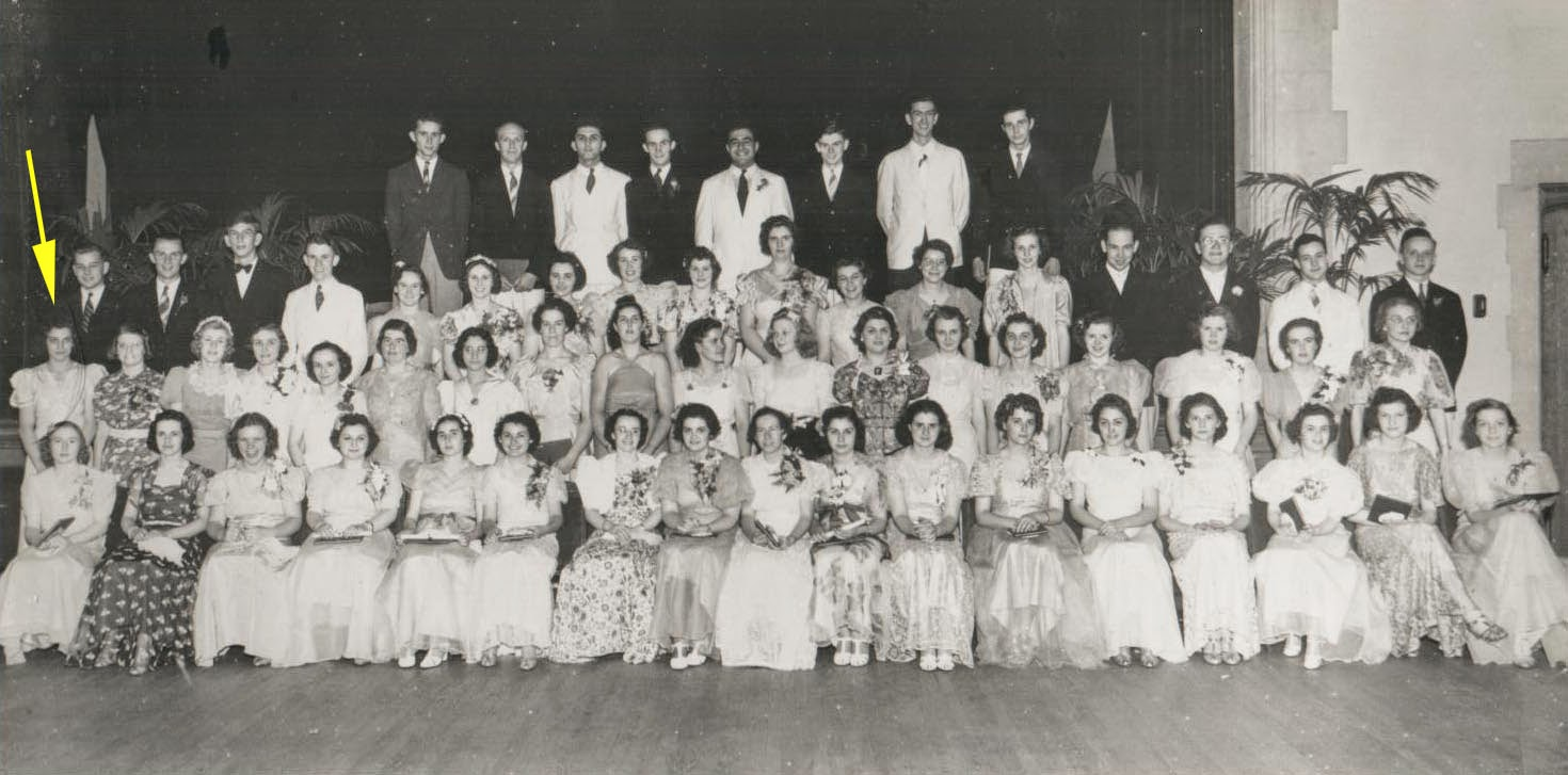Photo of students posing for a class photo in 1938.